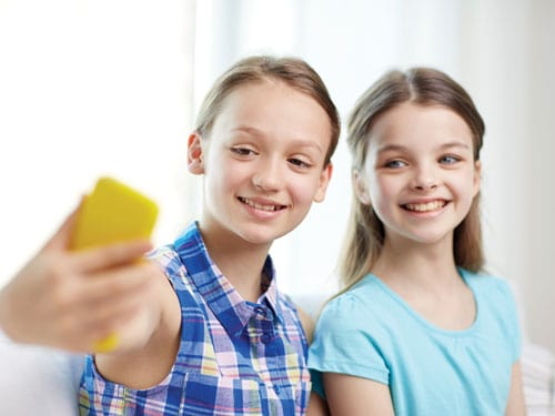 two_young_teenagers_taking_a_selfies